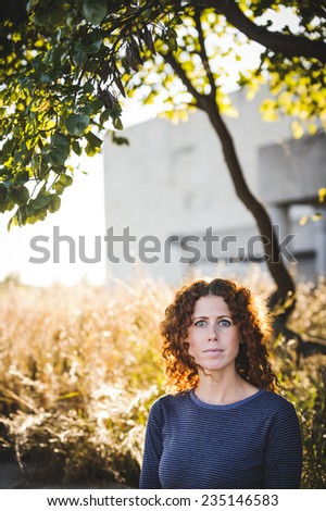 beautiful young woman outside in autumn - stock photo