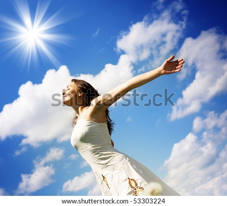 Beautiful Young Woman over blue Sky - stock photo