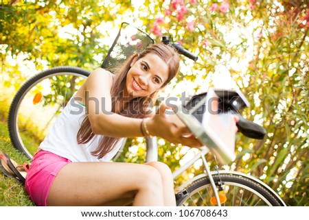 beautiful young woman playing with a vintage camera - stock photo