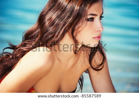 beautiful young woman portrait by the sea, profile, - stock photo