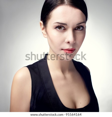 beautiful young woman portrait with brunette hair , studio shot - stock photo