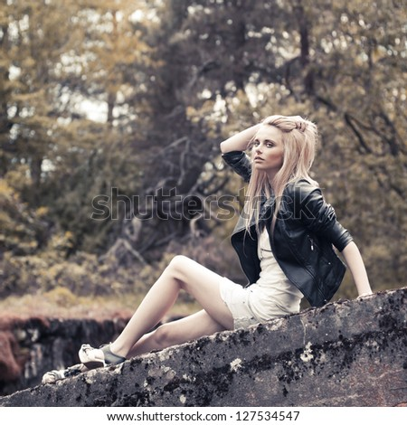 beautiful young woman posing in a forest - stock photo
