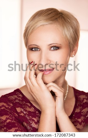 Beautiful young woman posing in front of ring light - stock photo