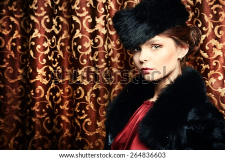 Beautiful young woman posing in fur. Luxury. Vintage style. Beauty, fashion. - stock photo