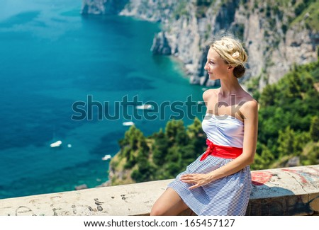 Beautiful young woman posing outdoors  - stock photo