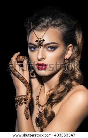 Beautiful young woman posing with a crown on her head - stock photo