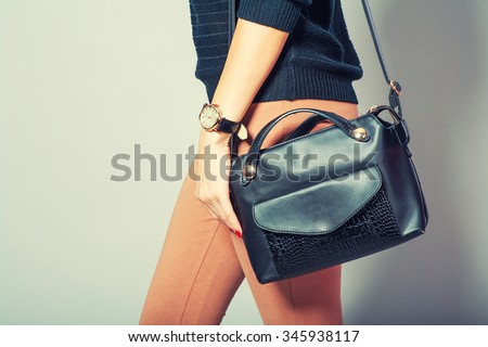 beautiful young woman posing with handbag and copy space. - stock photo