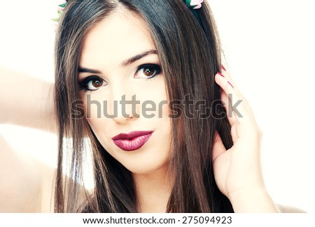Beautiful young woman posing with hands in a her head - stock photo