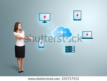 Beautiful young woman presenting cloud computing network - stock photo