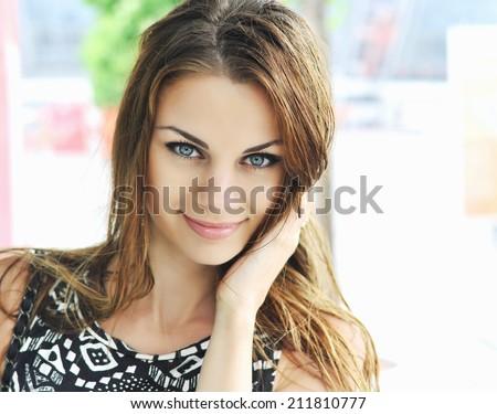 Beautiful young woman. Rain - stock photo