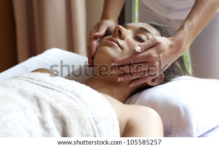 beautiful young woman relaxing in a spa situation - stock photo