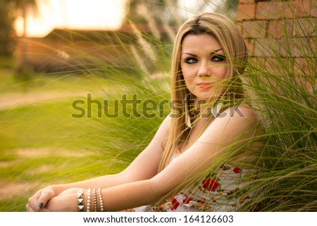 Beautiful Young Woman Relaxing In The Park - stock photo