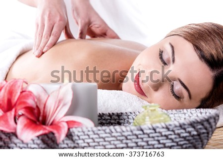 Beautiful young woman relaxing with hand massage - stock photo