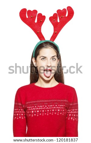 Beautiful young woman, santa claus with reindeer horns, showing tongue. On white background - stock photo