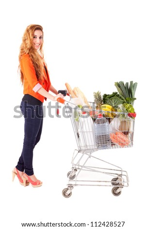 Beautiful young woman shopping at the supermarket - stock photo