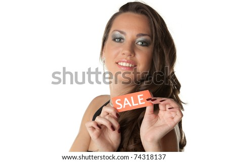 Beautiful young woman showing SALE sign on a white background. - stock photo