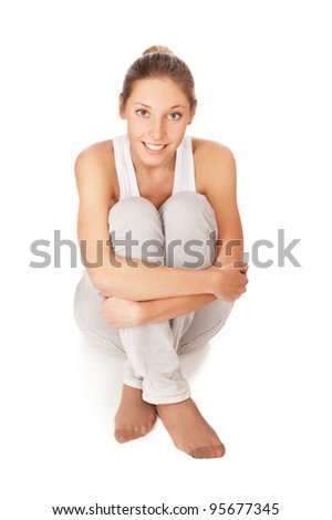 beautiful young woman sit on the floor isolated on white background - stock photo