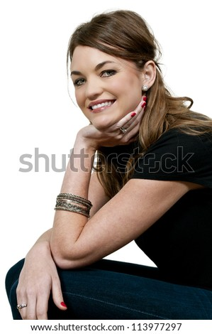Beautiful young woman sitting down and smiling - stock photo