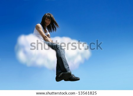 Beautiful young woman sitting on white cloud - stock photo