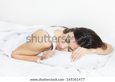 Beautiful young woman sleeping in the bed. - stock photo