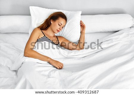 Beautiful Young Woman Sleeping On White Bedding ( Linen ) In Her Bedroom In Morning. Closeup Portrait Of Attractive Girl Lying On Bed Before Waking Up. Female Having Healthy Sleep At Home - stock photo