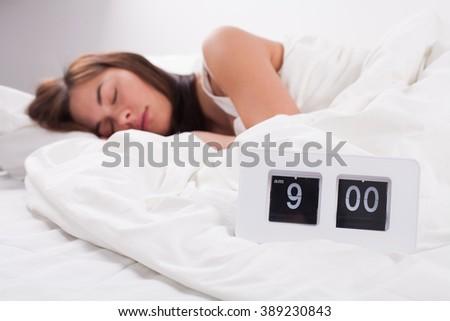 beautiful young woman sleeps - stock photo