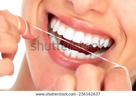 Beautiful young woman smile. Dental health background. - stock photo