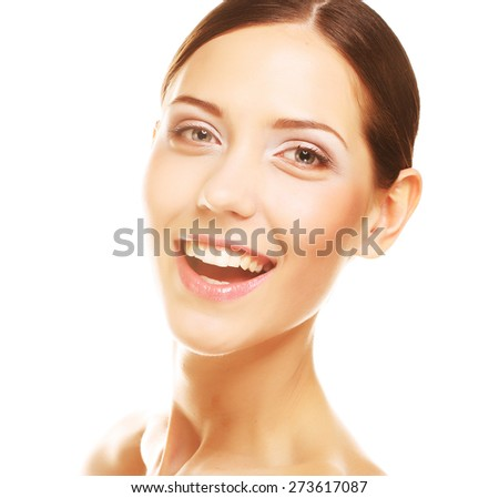 Beautiful young woman smiling against white background.  - stock photo