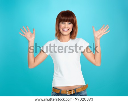 beautiful, young woman, smiling and waving her hands, on blue background - stock photo