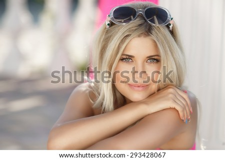 Beautiful young woman smiling outdoors, happy girl summer portrait, pretty female at beach vacation, happy woman face close up, beauty girl outdoor portrait, series - stock photo