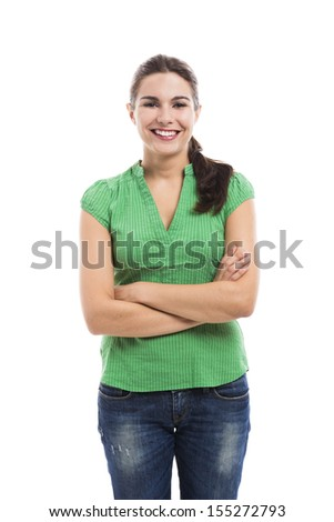 Beautiful young woman smilling, standing over a white background - stock photo