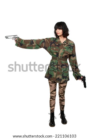 Beautiful young woman soldier with a gun - stock photo