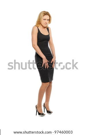 Beautiful young woman stands and looks angry with hands on hips - stock photo