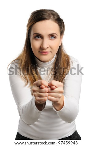 Beautiful young woman stands and show fig - stock photo