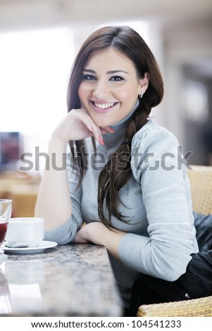 beautiful young woman student portrait while relax on coffee break - stock photo