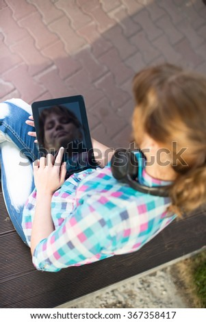 Beautiful young woman student with note pad. Outdoor student. - stock photo