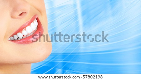 Beautiful young woman teeth. Over  blue background - stock photo