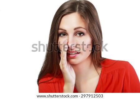 Beautiful Young Woman Telling a Secret - stock photo