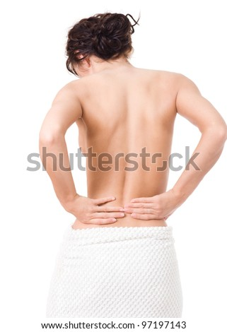 Beautiful young woman touching the back - stock photo