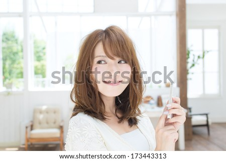 Beautiful young woman using a cellular. - stock photo