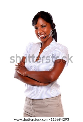 Beautiful young woman using headphones against white background - stock photo