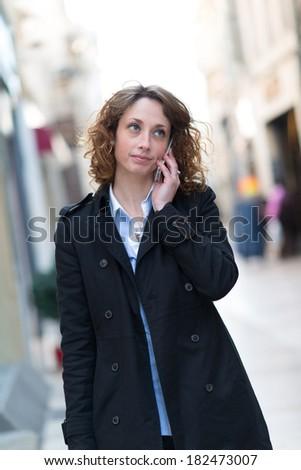 beautiful young woman walking and shopping downtown - stock photo