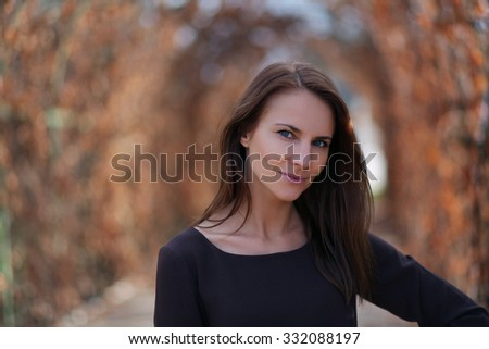 beautiful young woman walking in park - stock photo