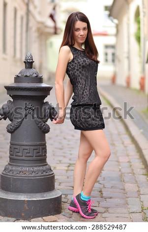 beautiful young woman walking in riga - stock photo