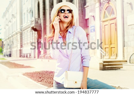 Beautiful young woman walking in the city. - stock photo