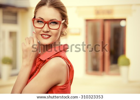Beautiful young woman walking in the city. Beauty, fashion. Businesswoman outdoor. - stock photo