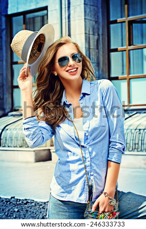 Beautiful young woman walking in the city. Fashion. - stock photo