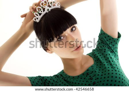 Beautiful young woman wearing a crown. Isolated on white. - stock photo