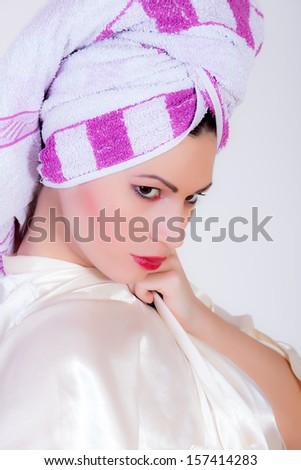 beautiful young woman wearing a towel  - stock photo