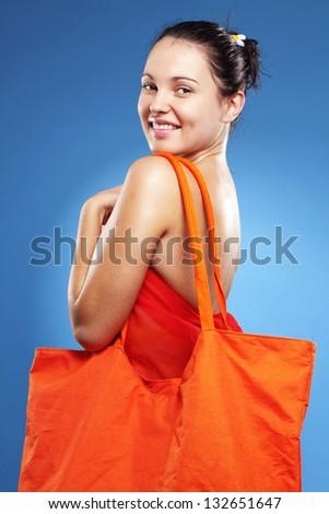 Beautiful young woman wearing big summer bag studio series - stock photo